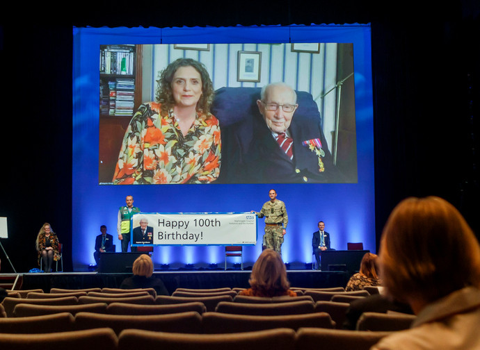 Captain Tom Moore, right on screen, and his daughter Hannah Ingram-Moore speaking via video-link at the opening of NHS Nightingale Hospital Yorkshire and Humber in Harrogate