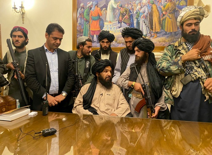 Taliban militants in the Presidential Palace in Kabul